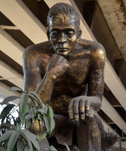 A replica of The Thinker, by French Sculptor Auguste Rodin, under a flyover in Guwahati, as a memorial of a bomb blast in 2008. Photo by Manash Das, Guwahati