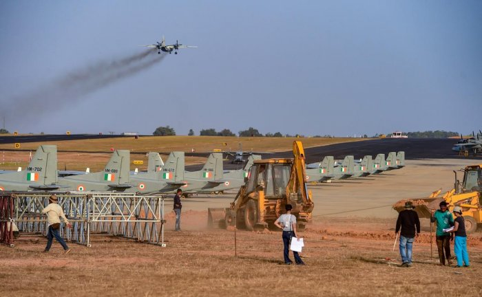 An earthmover clears a path during preperations ahead of 'Aero India Show 2019', at Yelahanka Air Base station in Bengaluru, Wednesday, Jan. 30, 2019. (PTI Photo)