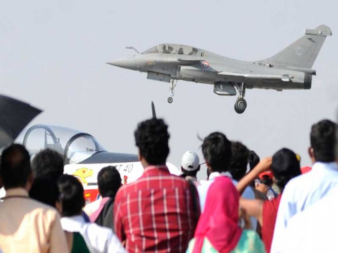 A Rafale on flight display as crowds watch at the 2017 airshow in Yelahanka. DH file photo