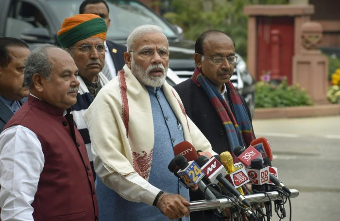 Prime Minister Narendra Modi, flanked by Parliamentary Affairs Minister NS Tomar and Ministers of State Arjun Ram Meghwal, Vijay Goel and Jitendra Singh, addresses the media on the first day of the Budget Session of Parliament, in New Delhi. PTI photo