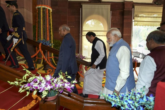 President Ram Nath Kovind, accompanied by Vice President M. Venkaiah Naidu and Prime Minister Narendra Modi, proceeds towards the Central Hall of Parliament to address the joint session of both the Houses on the first day of Budget Session. PTI photo