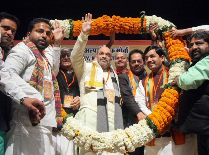 BJP president Amit Shah being garlanded during Muslim Minority Sammelan, in New Delhi, Thursday. PTI