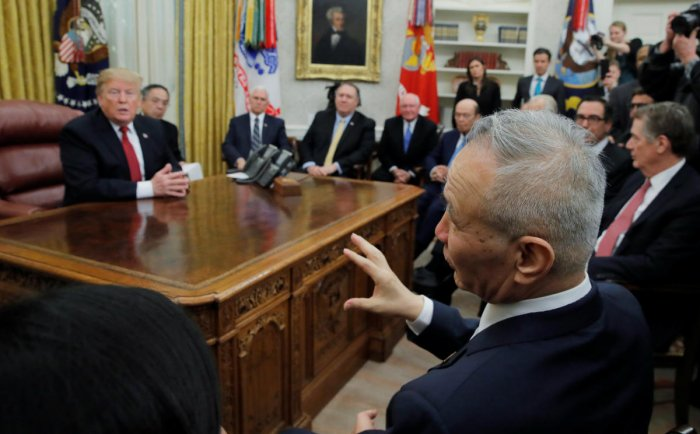 US President Donald Trump listens to China's Vice Premier Liu He (R) in the Oval Office of the White House in Washington. (REUTERS)