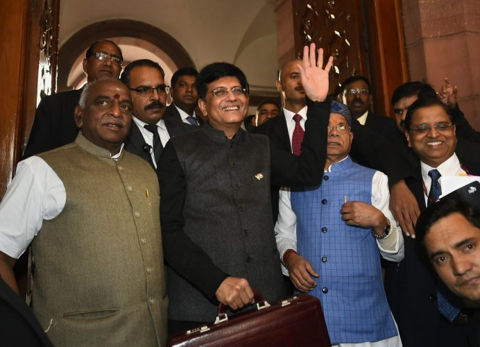Finance Minister Piyush Goyal, with MoS Finance minister Shiv Pratap Shukla, arrives in the Parliament to present the interim Budget 2019-20, in New Delhi on February 1, 2019. PTI