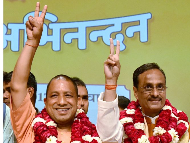 """Dinesh Sharma (R) also dubbed the SP-BSP alliance as """"opportunist""""."""