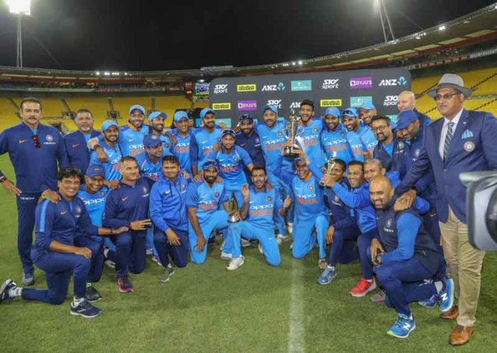 India's players celebrate with the series trophy after beating New Zealand in the fifth one day international at Westpac Stadium in Wellington, New Zealand.  (AP/PTI Photo)