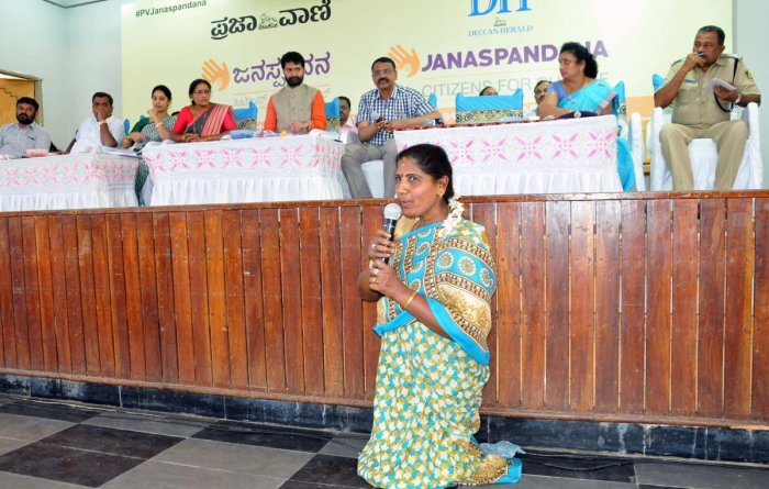 A differently abled woman airs her grievances during 'Janaspandana' programme organised by Prajavani and Deccan Herald at Brahma Samudra Shri Ranganna Kalyana Mantap on Basavanahalli Main Road in Chikkamagaluru on Saturday.