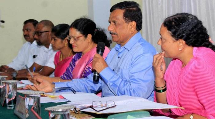 MLA K G Bopaiah speaks at the quarterly review meeting of KDP at Madikeri Taluk Panchayat on Saturday.