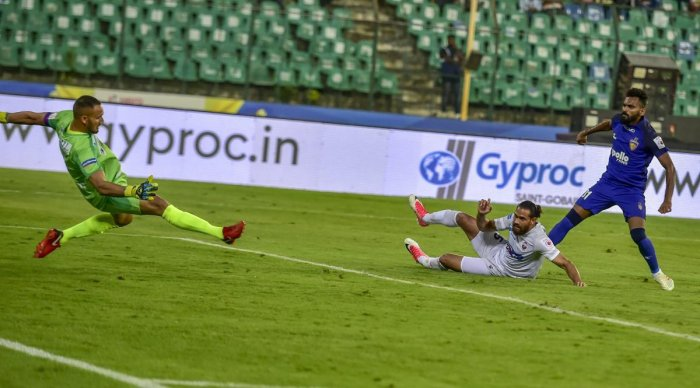 Chennaiyin FC's CK Vineeth (blue jersey) scores against FC Pune City during their ISL match in Chennai on Saturday. PTI
