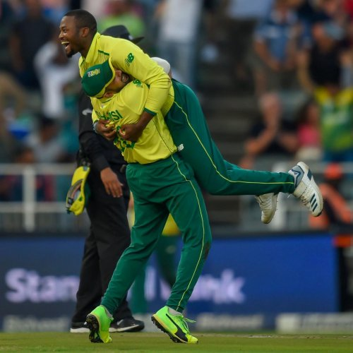 South Africa's Tabraiz Shamsi (left) and South Africa's Andile Phehlukwayo celebrate after getting the wicket of Pakistan's Shoaib Malik. AFP