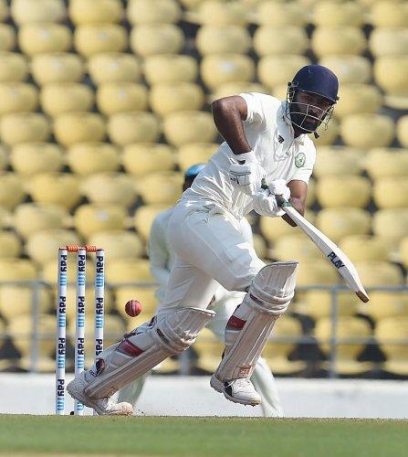 Vidarbha's Akshay Karnewar plays a shot during their match against Saurashtra in Nagpur on Monday. PTI