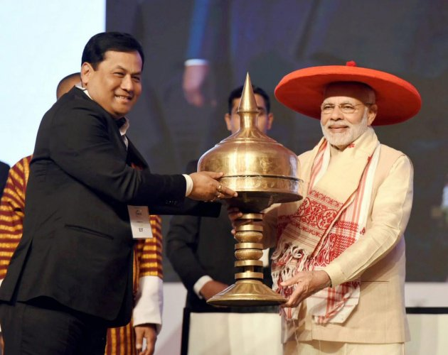 Prime Minister Narendra Modi being felicitated by Assam Chief Minister Sarbananda Sonowal during the inauguration of Advantage Assam programme at Indira Gandhi Athletic Stadium, in Guwahati on Saturday. (PTI File Photo)