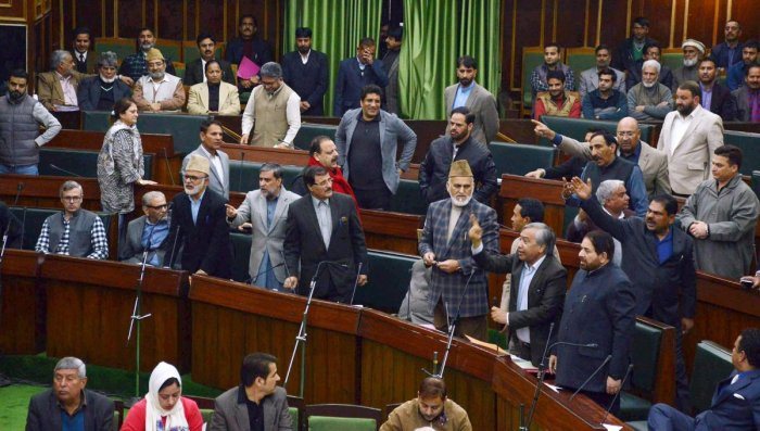 National Conference and Congress MLA's protest inside the J&K Legislative assembly during the budget session in Jammu on Wednesday. PTI