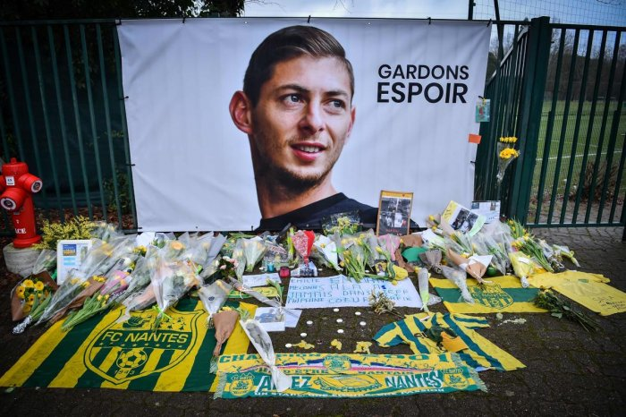 TRIBUTE: Flowers put in front of the entrance of the training center La Joneliere in La Chapelle-sur-Erdre on January 25, four days after the plane of Emiliano Sala vanished. AFP