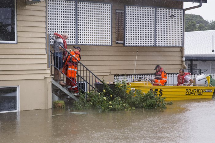 SES volunteers are seen rescuing residents in Rosslea, Townsville, Queensland, Australia. Reuters/AAP.