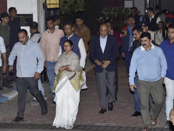 Mamata Banerjee comes out from Kolkata Police Commissioner Rajeev Kumar's residence, after CBI officials came to question the commissioner in connection with the Saradha ponzi scam. in Kolkata. PTI