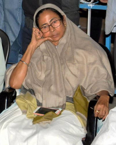 West Bengal Chief Minister Mamata Banerjee sitting on her 'Save the Constitution' dharna after CBI raids Kolkata Police Commissioner's residence in Kolkata. PTI photo.