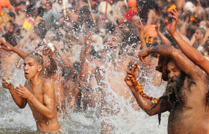 """Naga Sadhus take a dip during the second """"Shahi Snan"""" (grand bath) at """"Kumbh Mela"""" in Prayagraj. (Reuters Photo)"""