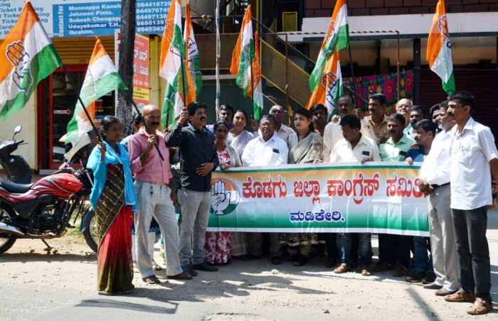 District Congress Committee members stage a protest in front of the Congress office in Madikeri on Monday.