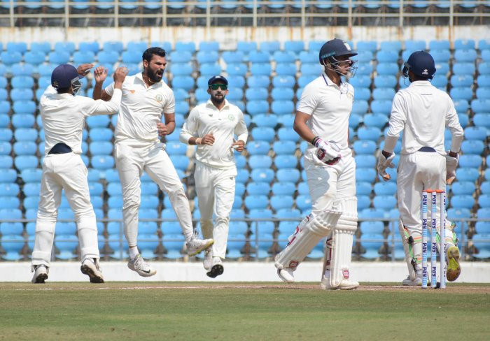 JOB WELL DONE: Vidarbha's left-arm spinner Aditya Sarwate (second from left) bowled brilliantly to bag the all-important wicket of Cheteshwar Pujara on Monday.