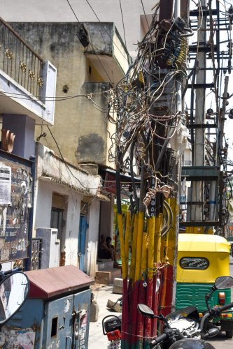 All such dangerously hanging overhead power cables will be eliminated in three years. DH FILE PHOTO