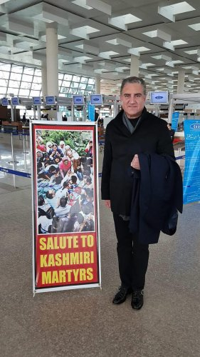 Pakistan Foreign Minister Shah Mehmood Qureshi poses for a photograph before leaving for London, at Islamabad airport, in Pakistan