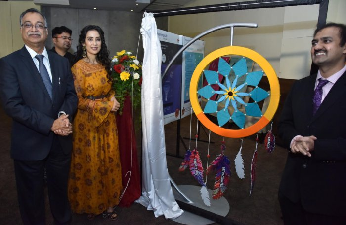 Manisha Koirala, bollywood actress and cancer survivor, during the World Cancer Day programme at the Manipal Hospital on Monday. (right) Dr H Sudarshan Ballal, Chairman of Manipal Hospitals is also seen. DH photo/Janardhan B K