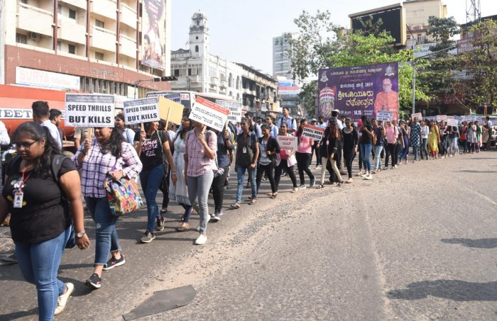 Students take out a rally to create awareness on road safety in Mangaluru on Monday.