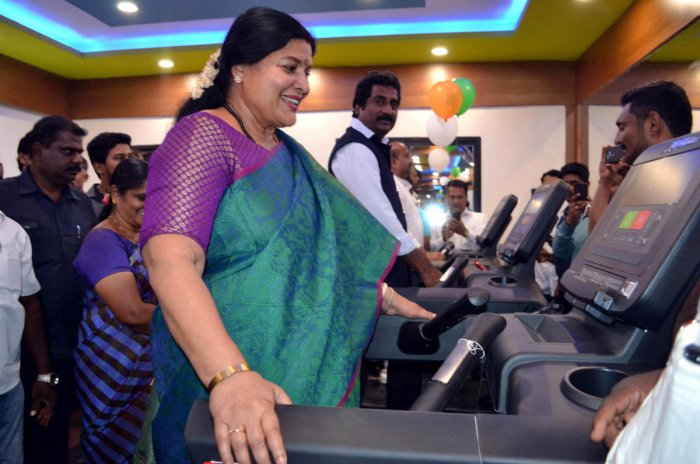 District In-charge Minister Jayamala and Minister for Youth Empowerment and Sports Rahim Khan walk on treadmill after the inauguration of synthetic tennis court in Udupi on Monday.(Right) Jayamala plays tennis on the occasion.