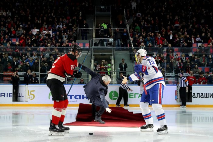 Former Manchester United manager Jose Mourinho (centre) falls as he drops the puck to start a Continental hockey league match between Avangard Omsk and SKA Saint Petersburg in Balashikha. AFP