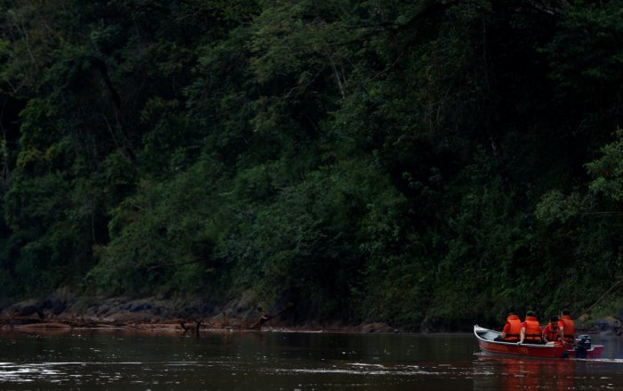 Members of a rescue team sit in a boat on Paraopeba River as they search for victims of a collapsed tailings dam owned by Brazilian mining company Vale SA, in Brumadinho, Brazil. Reuters