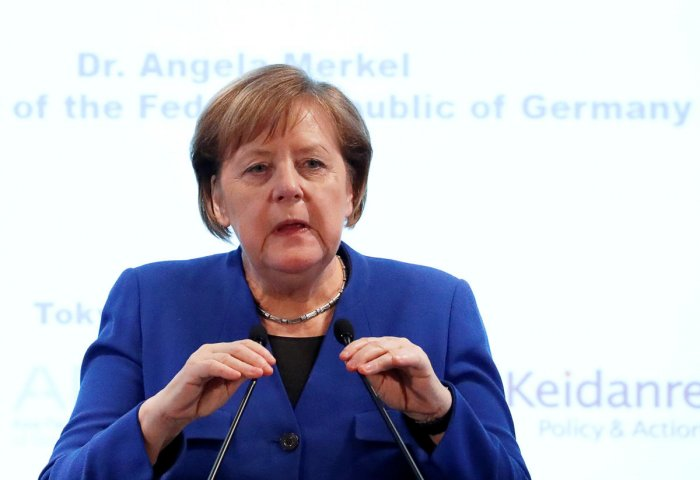 German Chancellor Angela Merkel delivers a speech at the German-Japanese Dialogue Forum in Tokyo. Reuters