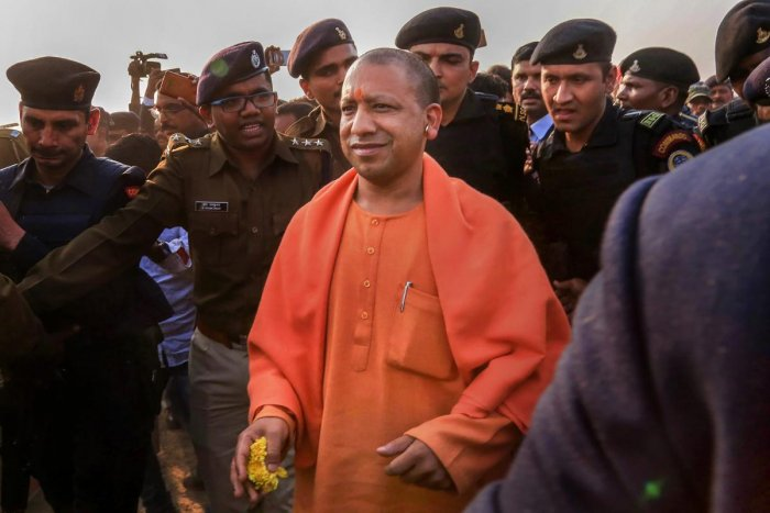 Chief Minister of Uttar Pradesh Yogi Adityanath arrives at Chas area helipad under Bokaro district of Jharkhand, Tuesday, Feb 5, 2019, to attend a rally of Bharatiya Janata Party (BJP) in Purulia district of West Bengal. The chief minister flew to Jharkhand's Bokaro before travelling to Purulia by road due to alleged denial of permission for his landing in West Bengal. (PTI Photo)