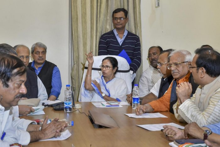 West Bengal Chief Minister Mamata Banerjee chairs a cabinet meeting at the protest site during a sit-in over the CBI's attempt to question the Kolkata Police commissioner in connection with chit fund scams, in Kolkata. PTI