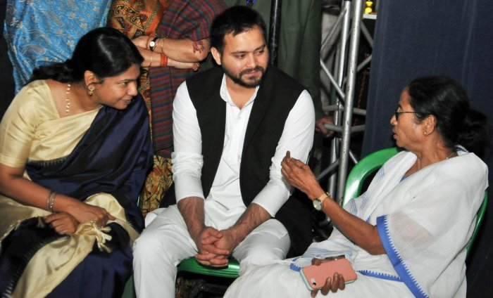 West Bengal Chief Minister Mamata Banerjee with DMK MP Kanimozhi (L) and RJD leader Tejashwi Yadav at Banerjee's sit-in over the CBI attempt's to question the Kolkata Police Commssioner in connection with chit funds scam, in Kolkata, on February 4, 2019.