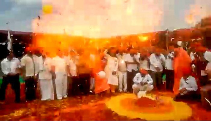 Flames erupt after balloons exploded at the inauguration of the wrestling tournament organised as part of Suttur Jathra in Nanjangud taluk, Mysuru district, on Tuesday. (Inset) Suttur seer sustained injuries in the incident. dh photo