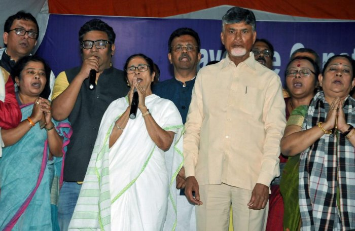 West Bengal Chief Minister Mamata Banerjee with TDP chief and Andhra Pradesh Chief Minister N Chandrababu Naidu stand for national anthem after announcing the end of her 46-hour-long 'Save Constitution' dharna in Kolkata, Tuesday, Feb 5, 2019. PTI