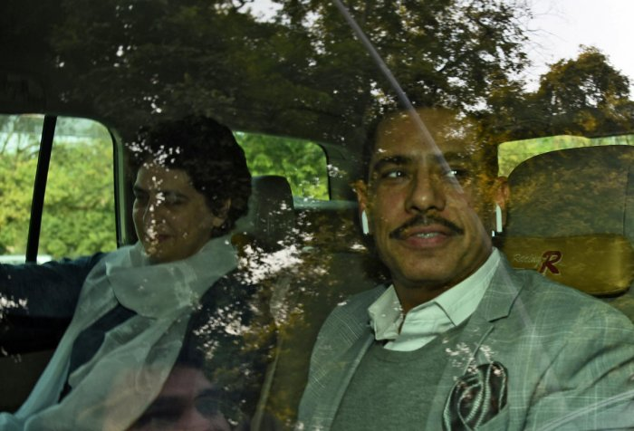 Priyanka Gandhi Vadra and her husband Robert Vadra are pictured outside the Enforcement Directorate, in New Delhi on Wednesday. REUTERS