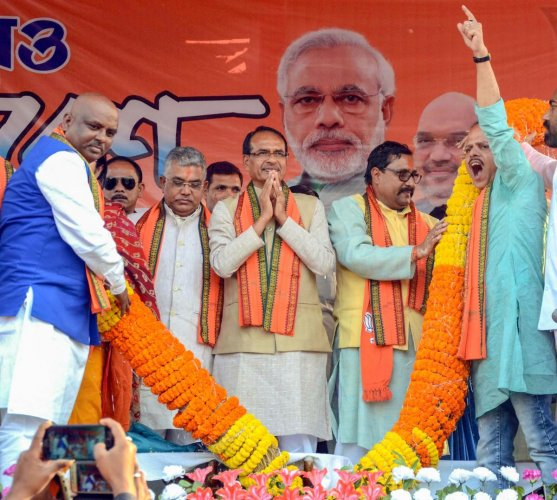 Senior BJP leader Shivraj Singh Chouhan being garlanded during party's rally, at Kharagpur in West Midnapore district of West Bengal, Wednesday, Feb 6, 2019. PTI