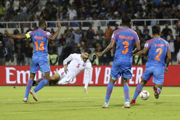 India's midfielder Pronay Halder (1st-L) fouls Bahrain's defender Hamad Alshamsan (2nd-L) during the 2019 AFC Asian Cup group A football match between India and Bahrain at the Sharjah Stadium in Sharjah on January 14, 2019. (AFP Photo)