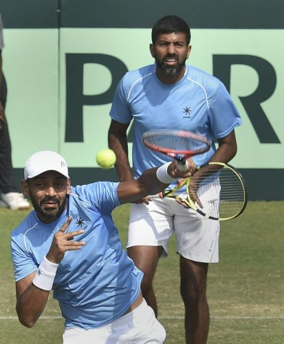 CONSOLATION WIN: India's Divij Sharan (front) and Rohan Bopanna won their doubles rubber but it still wasn't enough as Italy wrapped a convincing 3-1 win in Kolkata on Saturday. PTI