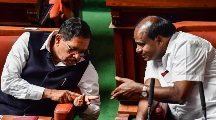 Every member counts: Deputy Chief Minister G Parameshwara appears to be giving a count of the Congress legislators who gave the legislature session a miss to Chief Minister H D Kumaraswamy in Bengaluru on Wednesday. Ten coalition legislators failed to tur