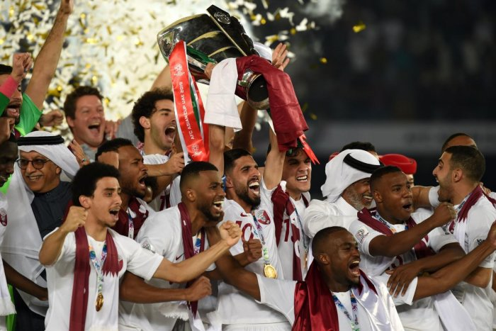Qatar's players celebrate with the trophy after winning the 2019 AFC Asian Cup final football match between Japan and Qatar at the Zayed Sports City Stadium in Abu Dhabi on February 1, 2019. (AFP File Photo)