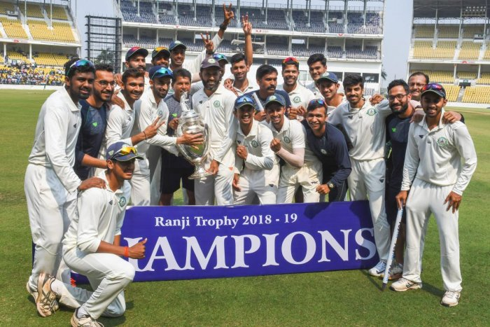 Vidarbha players celebrate with the Ranji Trophy after defeating Saurashtra in the final in Nagpur on Thursday. PTI