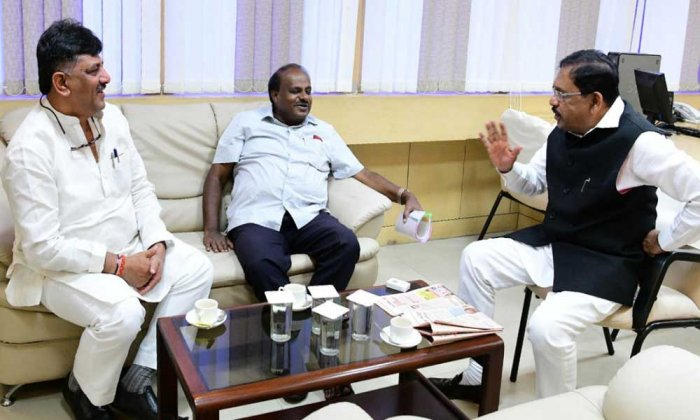 COMBAT PLAN: Chief Minister H D Kumaraswamy (centre) with deputy G Parameshwara (right) and Water Resources Minister D K Shivakumar in Bengaluru on Monday.