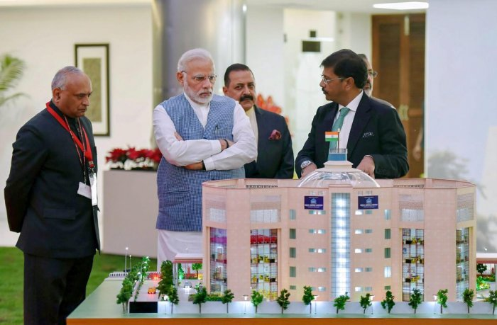 Prime Minister Narendra Modi views a model of the newly inaugurated premises of the Central Information Commission, in New Delhi. PTI File Photo