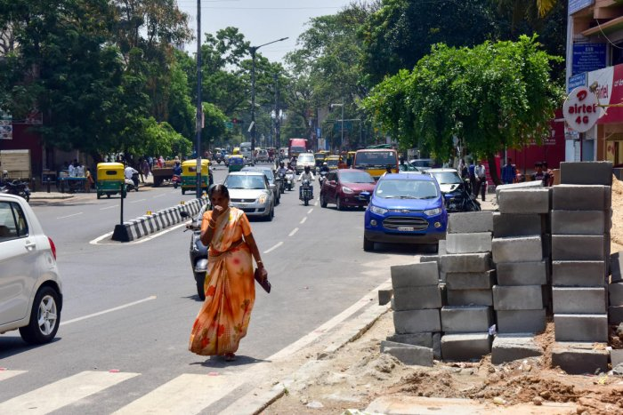 Footpath encroachments pose a risk to pedestrians by forcing them to walk on the road.