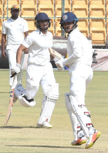 DOUBLE TROUBLE Karun Nair (left) and Manish Pandey struck unbeaten half-centuries to guide Karnataka to a six-wicket over Rajasthan in their Ranji Tophy quarterfinal at the M Chinnaswamy Sadium in Bengaluru on Friday. DH Photo/ Srikanta Sharma R
