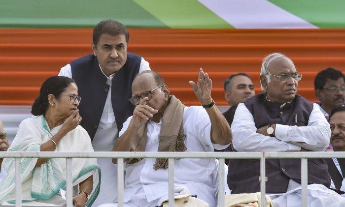 West Bengal Chief Minster Mamata Banerjee with NCP President Sharad Pawar and Congress leader Mallikarjun Kharge during the TMC mega rally 'Brigade Samavesh', in Kolkata on Saturday. PTI