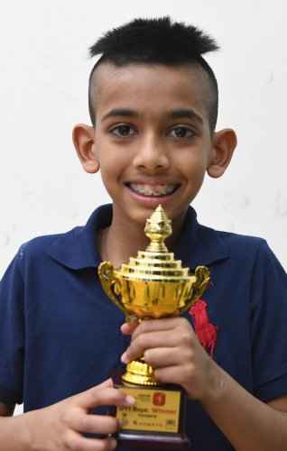 Rahul Sanjay Balakrishnan is all smiles after winning the under-11 title in the just-concluded 5Sports Century Bangalore Open squash tournament. DH PHOTO/ SRIKANTA SHARMA R